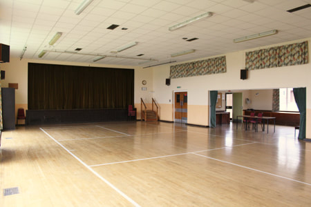 The spacious Main Hall, with raised stage, separate lounge, bar and kitchen facilities